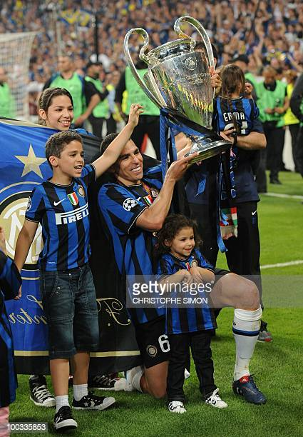 Inter Milan's Brazilian defender Lucio Da Silva Ferreira Lucimar celebrates with the trophy after winning the UEFA Champions League final football...