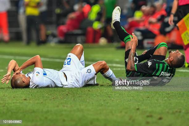 Inter Milan's Brazilian defender Miranda and Sassuolo's Ghanaian forward KevinPrince Boateng react in pain after colliding during the Italian Serie A...