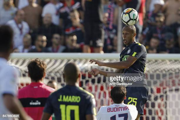Inter Milan's Brazilian defender Miranda heads the ball during the Italian Serie A football match FC Crotone vs FC Internazionale Milano on September...