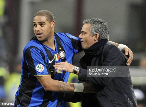 Inter Milan's Brazilian forward Adriano and Inter Milan's Portuguese coach Jose Mourinho clelbrate after a goal during the Italian Serie A match...