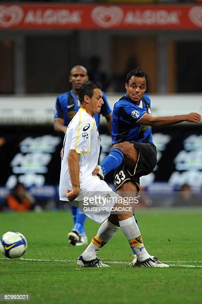 Inter Milan's Brazilian forward Amantino Mancini kicks the ball in front of Lecce's defender Fabiano and Lecce's defender Andrea Esposito during...