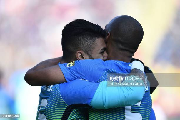 Inter Milan's Brazilian forward Gabriel Barbosa Almeida celebrates with teammate Portuguese midfielder Joao Mario after scoring a goal during the...