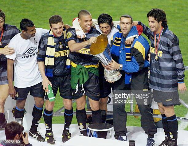 Inter Milan's Brazilian forward Ronaldo and his teammates celebrate with the UEFA Cup on the podium after winning the soccer final against Lazio Rome...