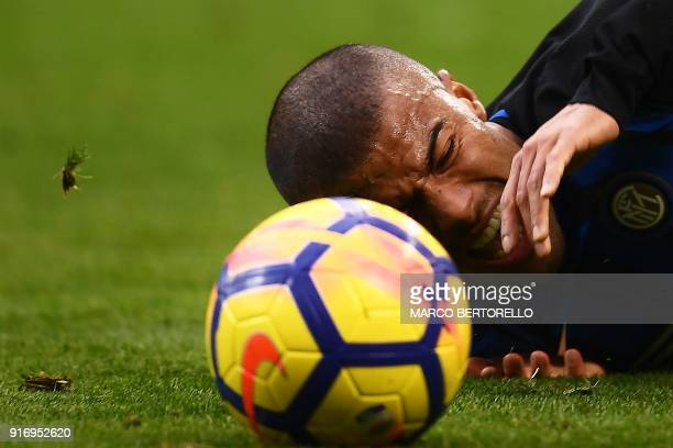Inter Milan's Brazilian midfielder Rafinha Alcantara falls during the Italian Serie A football match Inter Milan Vs Bologna on February 11 2018 at...