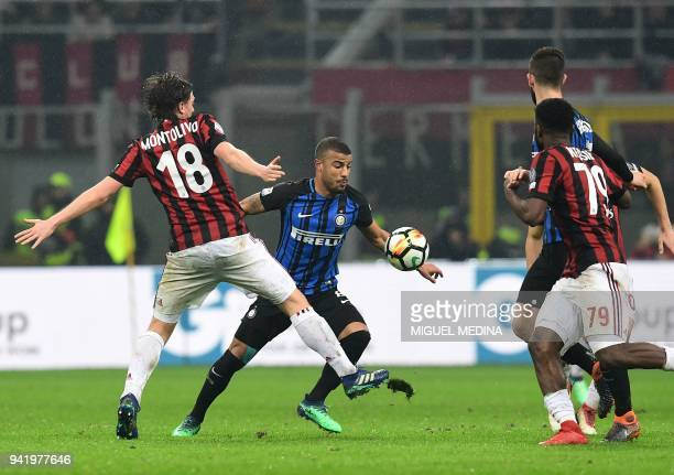 Inter Milan's Brazilian midfielder Rafinha vies with AC Milan's Italian midfielder Ricardo Montolivo during the Italian Serie A football match AC...