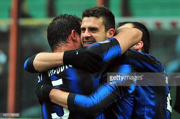 Inter Milan's Brazilian midfielder Thiago Motta celebrates after scoring with Inter Milan's Serbian midfielder Dejan Stankovic and Inter Milan's...
