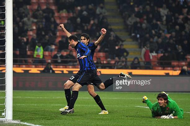 Inter Milan's Brazilian midfielder Thiago Motta celebrates with defender Andrea Ranocchia after scoring a goal in front of Cagliari's goalkeeper...