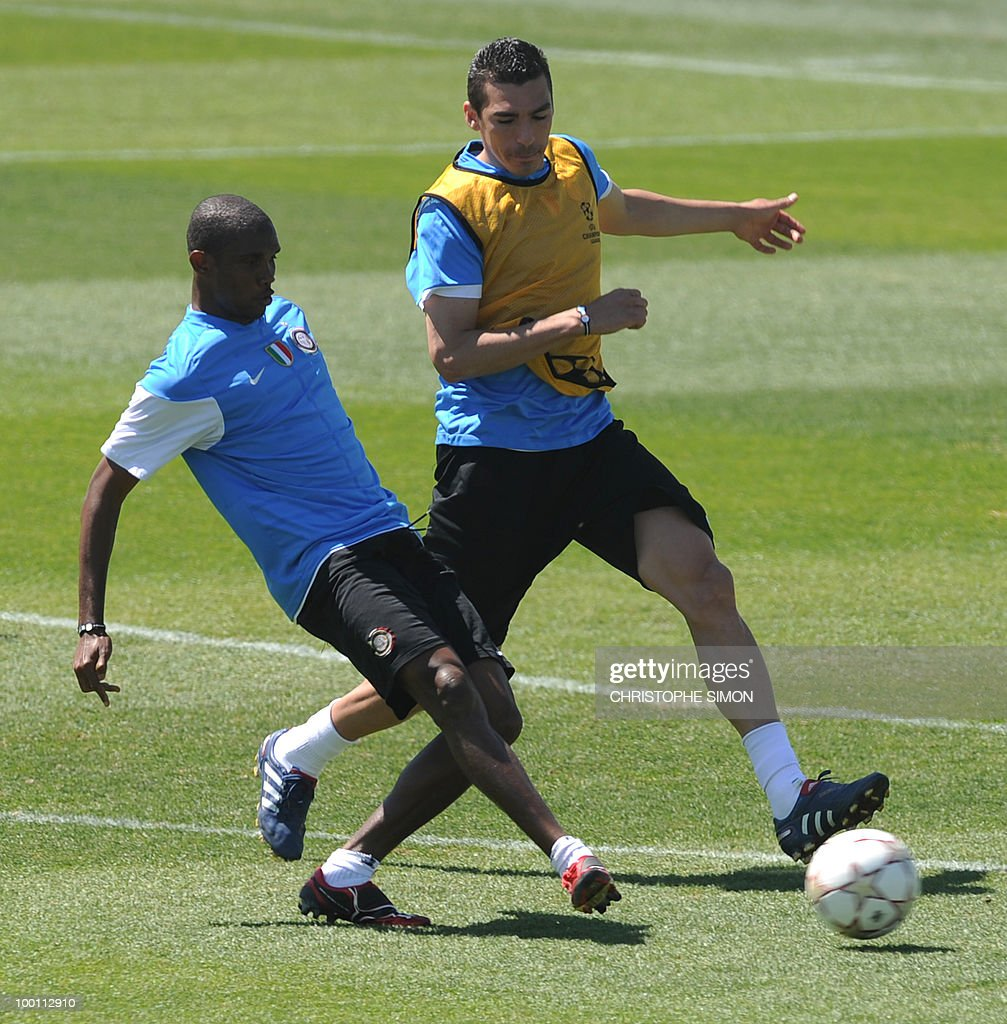 Inter Milan's Cameroonian forward Samuel Eto'o (L) and Brazilian defender Lucio Da Silva Ferreira take part in a team training session at the Alfredo Di Stefano stadium in Madrid, on May 21, 2010, on the eve of the UEFA Champions League Final against Bayern Munich.