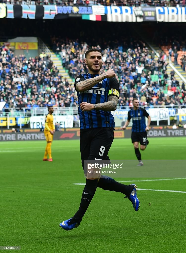 Inter Milan's captain Argentinian forward Mauro Icardi celebrates after scoring his 101st goal during the Italian Serie A football match Inter Milan vs Hellas Verona at the San Siro stadium in Milan on March 31, 2018. /
