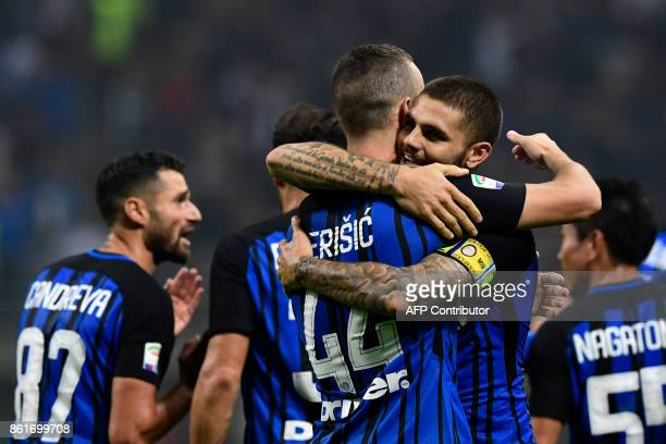 Inter Milan's Captain Argentinian forward Mauro Icardi celebrates with teammate Inter Milan's Croatian forward Ivan Perisic after scoring during the...