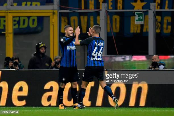 Inter Milan's Captain Argentinian forward Mauro Icardi celebrates with teammate Inter Milan's Croatian forward Ivan Perisic after scoring during the...