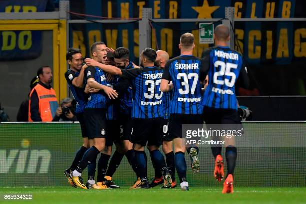Inter Milan's Captain Argentinian forward Mauro Icardi celebrates with teammates after scoring during the Italian Serie A football match Inter Milan...