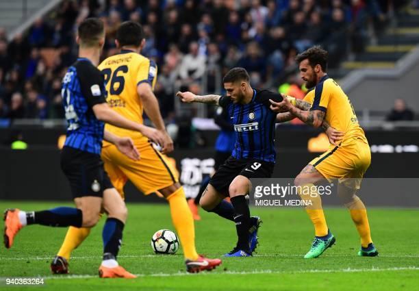 Inter Milan's Captain Argentinian forward Mauro Icardi vies with Hellas Verona's Italian defenderr Antonio Caracciolo during the Italian Serie A...