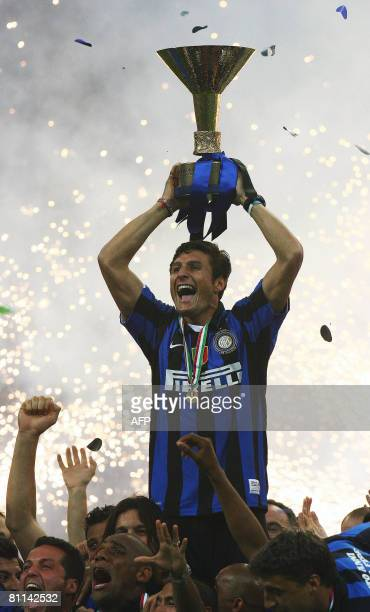 Inter Milan's captain Javier Zanetti lifts the trophy representing the Scudetto the Major league Italian Championship at San Siro Stadium in Milan on...