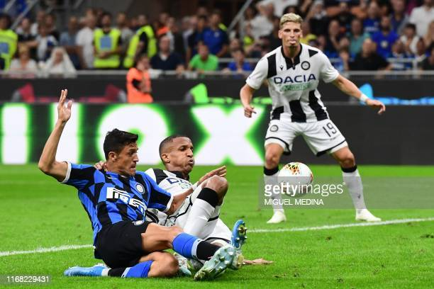 Inter Milan's Chilean forward Alexis Sanchez and Udinese's Brazilian defender Rodrigo Becao go for the ball during the Italian Serie A football match...