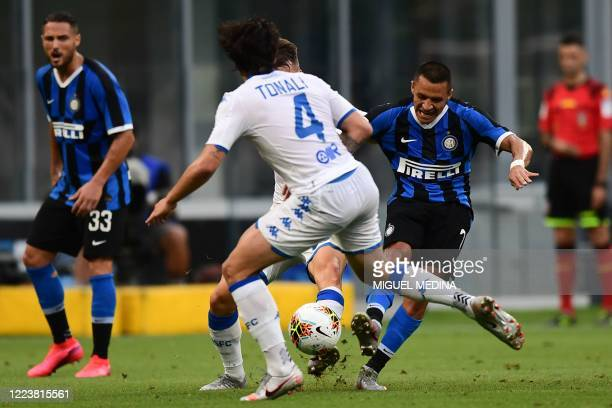 Inter Milan's Chilean forward Alexis Sanchez shoots on goal during the Italian Serie A football match Inter vs Brescia played behind closed doors on...