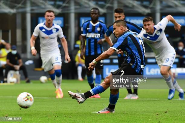 Inter Milan's Chilean forward Alexis Sanchez shoots to score a penalty during the Italian Serie A football match Inter vs Brescia played behind...