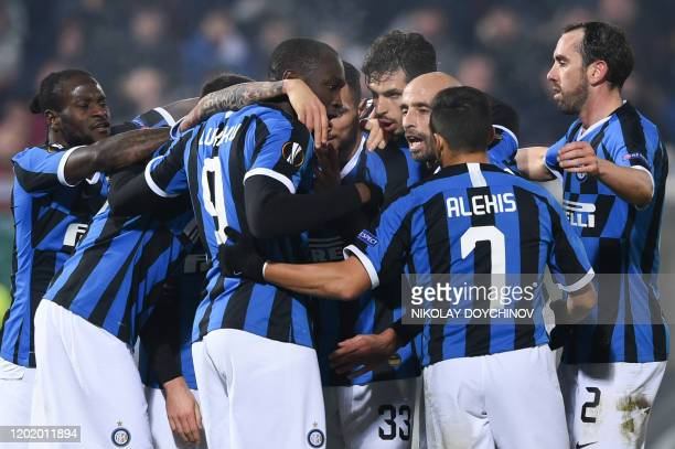 Inter Milan's Christian Eriksen from Denmark celebrates with teammates after scoring a goal during the UEFA Europa League round of 32 first leg...
