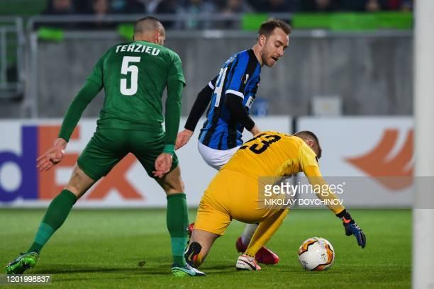 Inter Milan's Christian Eriksen from Denmark tries to score in front of Ludogorets Razgrad's Bulgarian defender Georgi Ilkov Terziev and Ludogorets...
