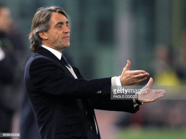 Inter Milan's coach Roberto Mancini gestures during Lazio vs Inter Milan Serie A football match at Rome's Olympic stadium 12 March 2005 The match...