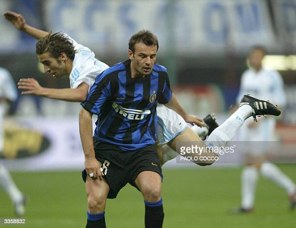Inter Milan's Cristiano Zanetti challenges Olympic de Marseille's Mathieu Flamini during their Uefa cup quarterfinals second leg match at Milan's San...