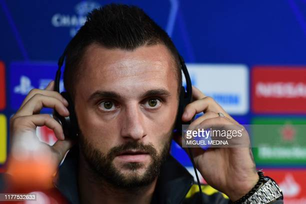 Inter Milan's Croatian defender Marcelo Brozovic adjusts his headset during a press conference on October 22, 2019 in Appiano Gentile, on the eve of...