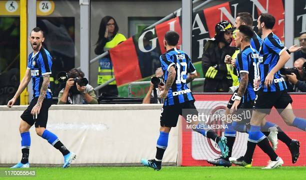Inter Milan's Croatian defender Marcelo Brozovic celebrates after AC Milan scored an own goal during the Italian Serie A football match AC Milan vs...