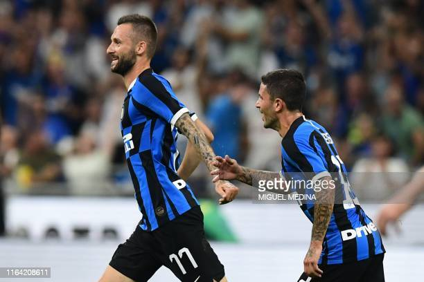Inter Milan's Croatian defender Marcelo Brozovic celebrates after scoring during the Italian Serie A football match Inter Milan vs US Lecce on August...