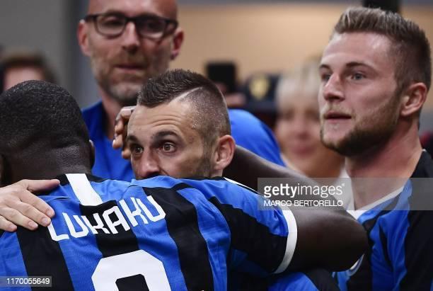 Inter Milan's Croatian defender Marcelo Brozovic celebrates with Inter Milan's Belgian forward Romelu Lukaku and Inter Milan's Slovakian defender...