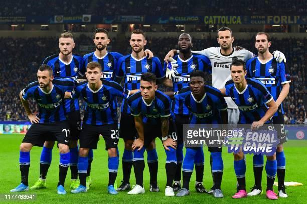 Inter Milan's Croatian defender Marcelo Brozovic Inter Milan's Italian midfielder Nicolo Barella Inter Milan's Argentinian forward Lautaro Martinez...