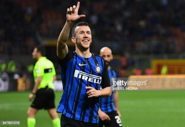 Inter Milan's Croatian forward Ivan Perisic gestures after scoring his team's fourth goal during the Italian Serie A football match between Inter...