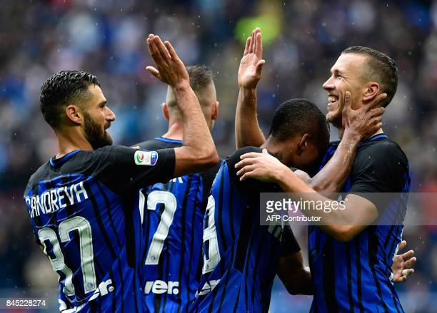 TOPSHOT Inter Milan's Croatian forward Ivan Perisic is congratulated by team mates after scoring during the Italian Serie A football match Inter...