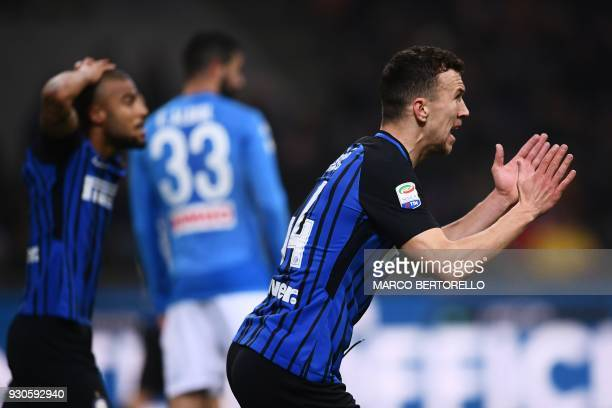 Inter Milan's Croatian forward Ivan Perisic reacts during the Italian Serie A football match Inter Milan vs Napoli on March 11 2018 at the San Siro...