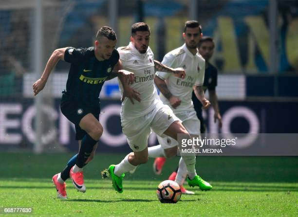 Inter Milan's Croatian forward Ivan Perisic vies with AC Milan's Argentinian midfielder José Sosa during the Italian Serie A football match Inter...