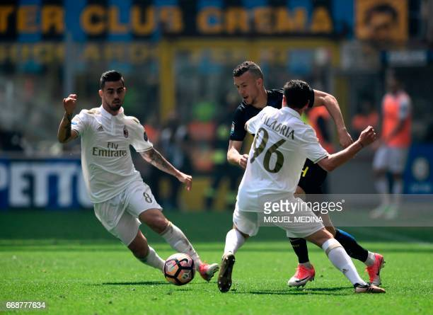 CORRECTION Inter Milan's Croatian forward Ivan Perisic vies with AC Milan's Italian defender Davide Calabria during the Italian Serie A football...
