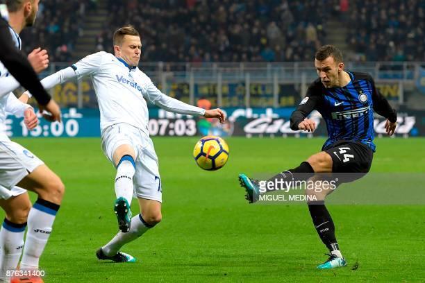 Inter Milan's Croatian forward Ivan Perisic vies with Atalanta's Slovenian forward Josip Ilicic during the Italian Serie A football match between...