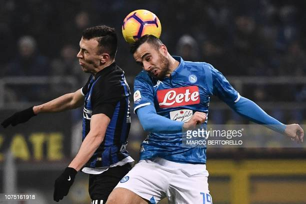 Inter Milan's Croatian midfielder Ivan Perisic and Napoli's Serbian defender Nikola Maksimovic go for a header during the Italian Serie A football...
