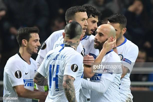 Inter Milan's Croatian midfielder Ivan Perisic celebrates with Inter Milan's Spanish midfielder Borja Valero and teammates after scoring his team's...