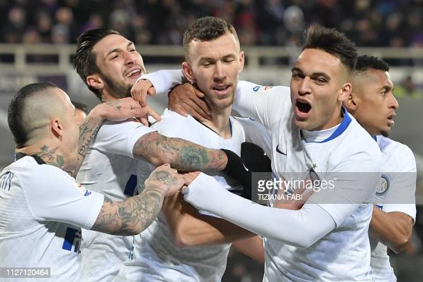 Inter Milan's Croatian midfielder Ivan Perisic celebrates with Inter Milan's Belgian midfielder Radja Nainggolan Inter Milan's Italian midfielder...
