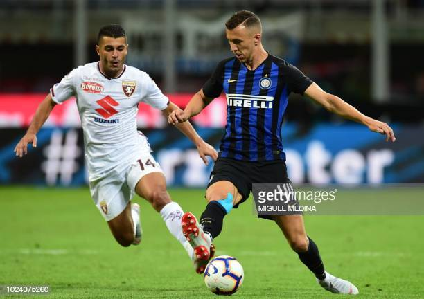 Inter Milan's Croatian midfielder Ivan Perisic holds off Torino's Spanish forward Iago Falque during the Italian Serie A football match Inter Milan...