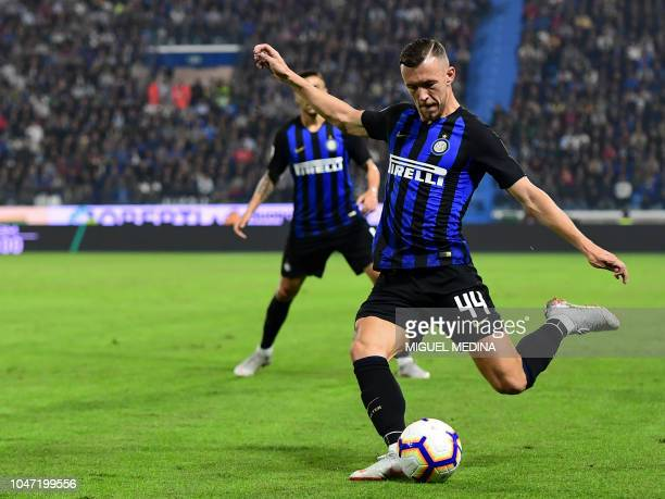 Inter Milan's Croatian midfielder Ivan Perisic kicks the ball during the Italian Serie A football match between Spal and Inter Milan in Ferrara on...