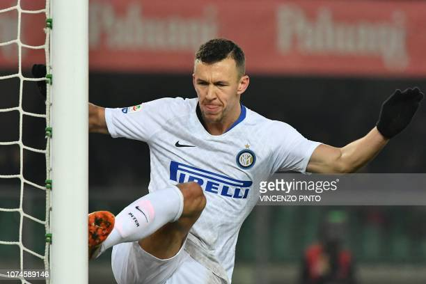 Inter Milan's Croatian midfielder Ivan Perisic kicks the goal's post as he celebrates after opening the scoring during the Italian Serie A Football...