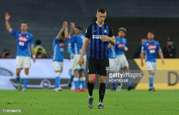 STADIUM NAPLES CAMPANIA ITALY Inter Milan's Croatian midfielder Ivan Perisic reacts as Napoli's players celebrate a goal during the Italian Serie A...