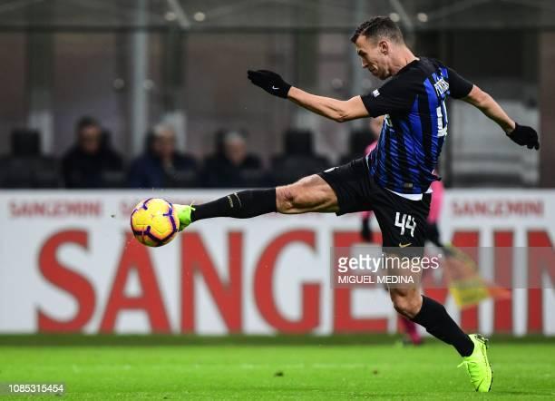 Inter Milan's Croatian midfielder Ivan Perisic shoots on goal during the Italian Serie A football match Inter Milan vs Sassuolo on January 19, 2019...