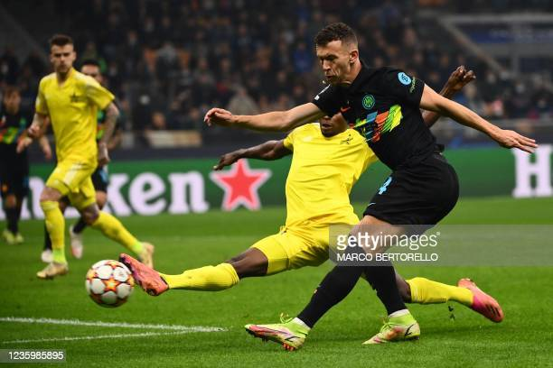 Inter Milan's Croatian midfielder Ivan Perisic shoots on target despite FC Sheriff's Colombian defender Danilo Arboleda during the UEFA Champions...