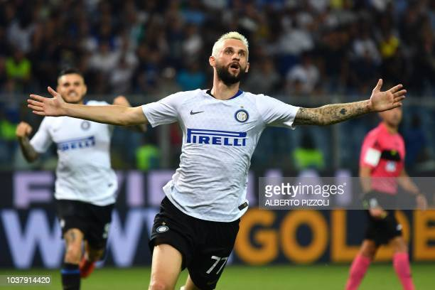 Inter Milan's Croatian midfielder Marcelo Brozovic celebrates after scoring a goal during the Italian Serie A football match between Sampdoria and...