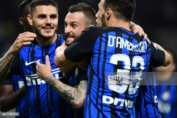 Inter Milan's Croatian midfielder Marcelo Brozovic celebrates with teammates after scoring during the Italian Serie A football match between Inter...