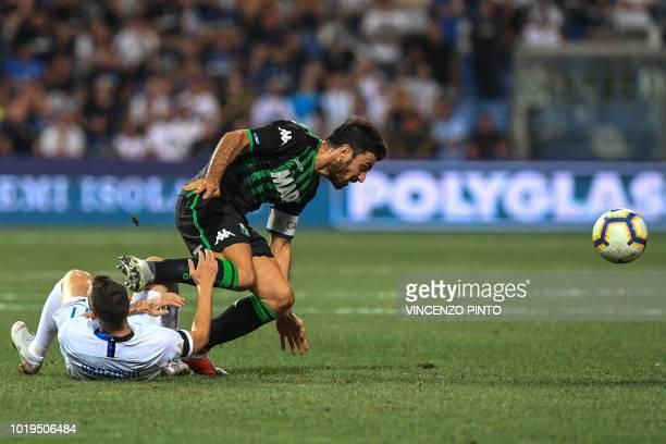 Inter Milan's Croatian midfielder Marcelo Brozovic collides with Sassuolo's midfielder Francesco Magnanelli during the Italian Serie A football match...