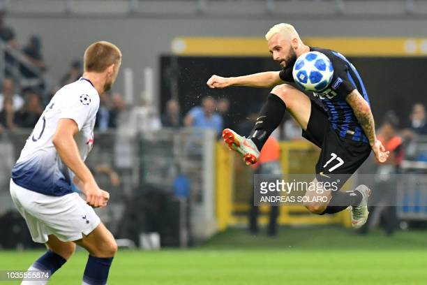 Inter Milan's Croatian midfielder Marcelo Brozovic kicks the ball during the UEFA Champions League group stage football match Inter Milan vs...