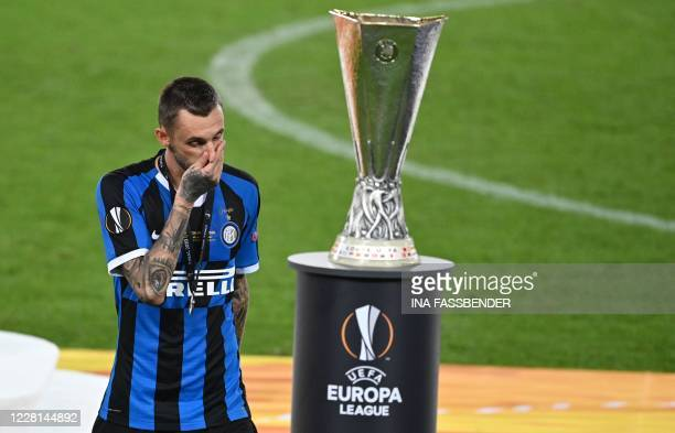 Inter Milan's Croatian midfielder Marcelo Brozovic reacts next to the trophy after losing the UEFA Europa League final football match Sevilla v Inter...